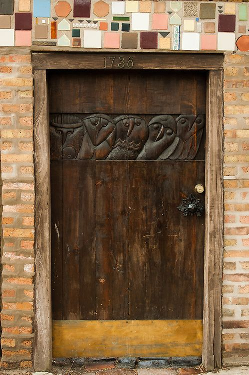 Wooden door with Owls engraved on it
