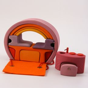 """home on-the-go  germany  compact little campervan houses! we adore toys like these that leave lots of room for imagination and invite adventure. gorgeous colors, versatile pieces and lots of creativity.    13 piece block set with 1300 ways to arrange them! also includes 2 small felt blanket/rug/bed/landing strip pieces plus large felt roof/driveway/rug/carry-all. wrap it up and away you go!    approximately 8"""" x 6"""" x 3"""" when closed.    solid german alder wood colored with non toxic water…"""