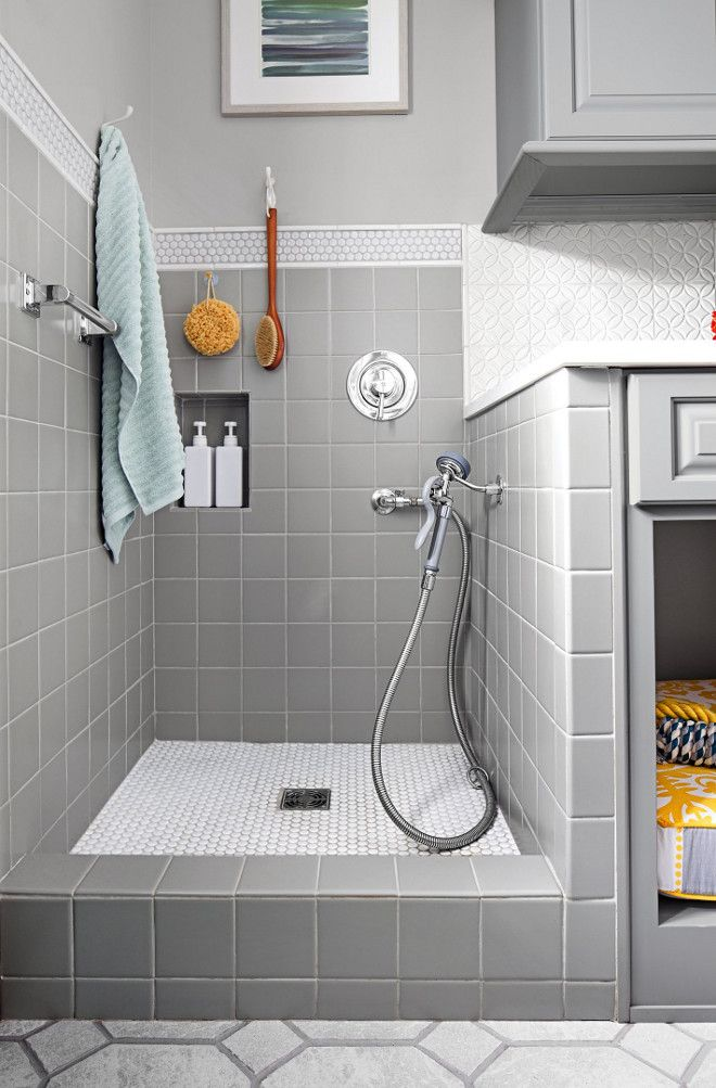 """Placing the handshower on one of the side walls keeps it within arm's reach. The penny-round tile floor ensures no slipping. Tiles are from """"American Olean"""" and handshower is from Moen.  Artistic Renovations of Ohio LLC via This Old House."""