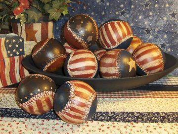 Paint old baseballs, antique them, spray when dry with matt sealer <~ love this!