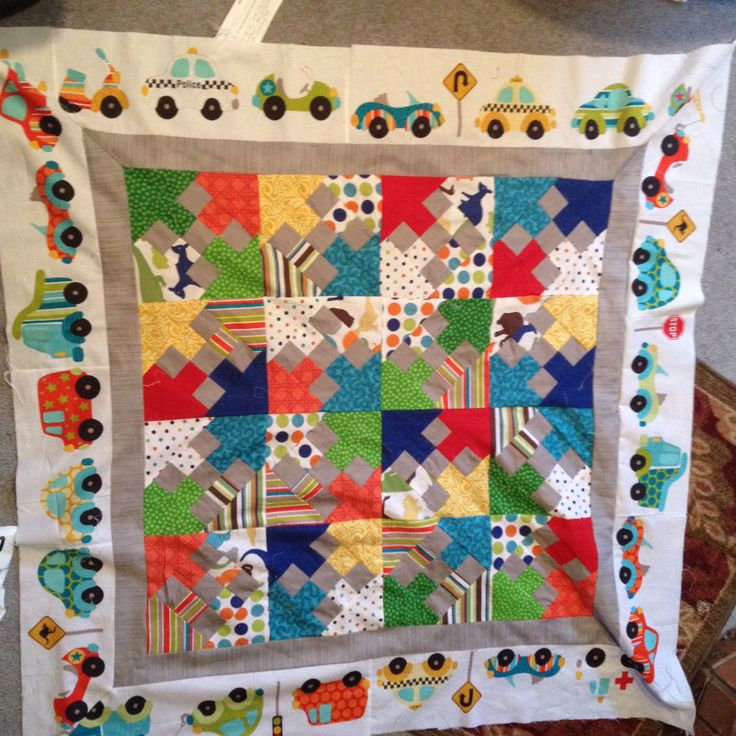 A beautiful quilt for a beautiful baby cousin I am awaiting. I used a miniature quilt pattern book and modified the boarders.