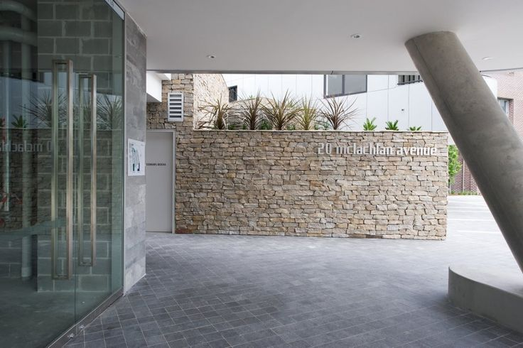 Dusky Dry Stone Wall cladding is made up of a mixture of split granite pieces. It has five split sides and the back of each piece is sawn to a flat finish, which allows Dusky to be fixed to appropriate substrates. #granitecladding #outdoorlife #cladding #sydneybuider #stonecladding #featurewall #outdoorenvirenment #cappingstone
