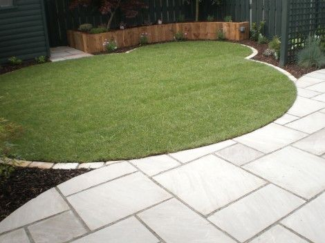 two concentric circles -- one in grass and the other in permeable/gravel etc for seating....
