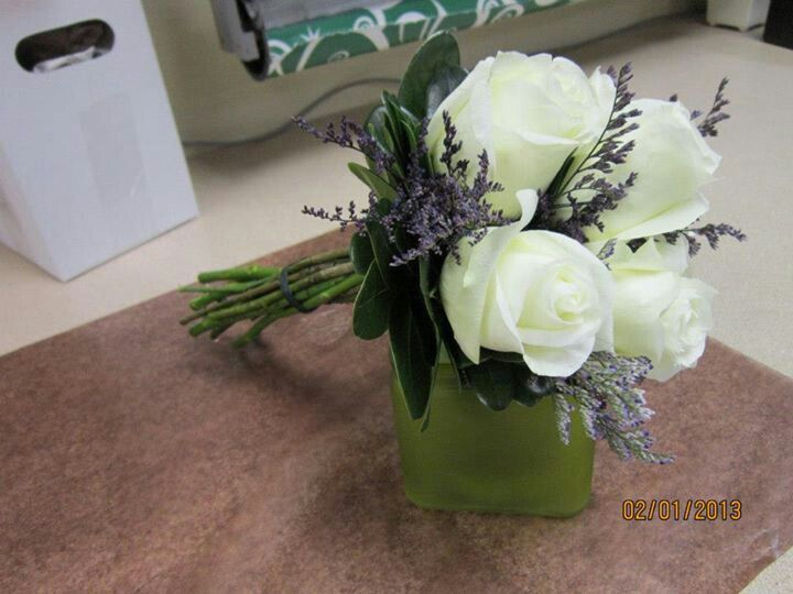 White roses with purple bridesmaid handheld