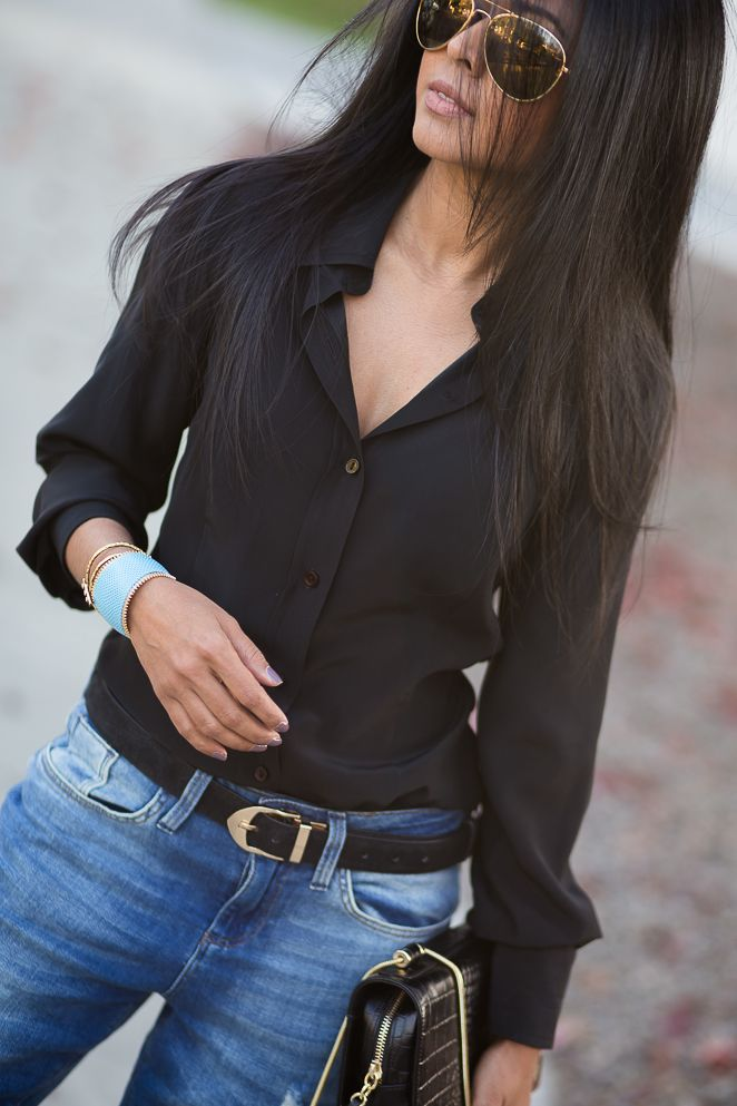 Sexy, understated outfit! Black button down shirt with jeans. Women's street style winter outfit