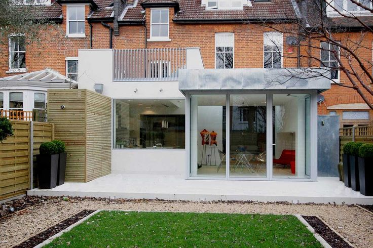 A fixed frameless structural window, or Picture Window, is frameless both internally and externally and provides a frameless look over the garden from the kitchen with sliding folding (bi fold) doors to the large structural opening.