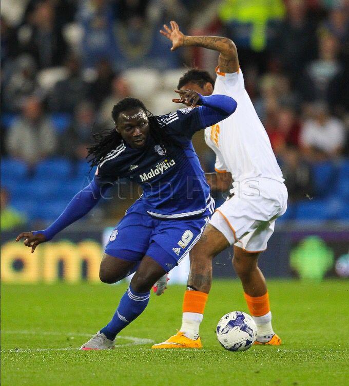Cardiff City's Kenwyne Jones takes on Hull City's Abel Hernandez.