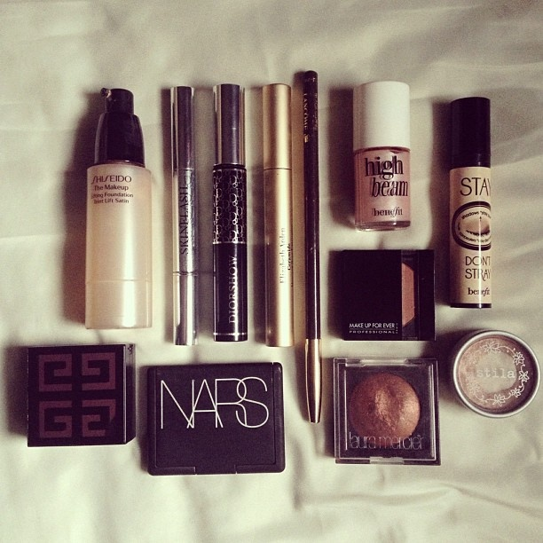 """""""I often get people asking how I do my makeup. This is what I generally use: Shiseido Lifting Foundation, Skinflash concealer/brightener by Dior, Dior Show mascara by Dior for upper lashes, Ceramide by Elizabeth Arden for lower lashes, Kohl pencil in Black Coffee by Lancome, High Beam highlighter by Benefit...."""""""