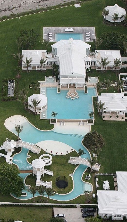 Celine Dion's Florida mansion or waterpark!! This place has so many cars and pool!! The pools are never ending!!