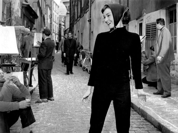 """The actress Audrey Hepburn (as Jo Stockton) photographed on a location in Montmartre, the famous bohemian neighborhood of Paris (France), during the filming of """"Funny Face"""", in May 1956. Audrey was..."""