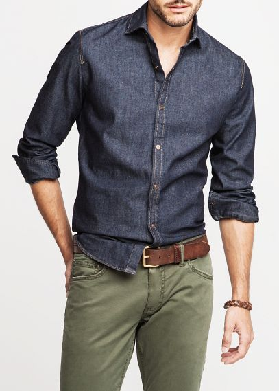 Shop this look on Lookastic:  http://lookastic.com/men/looks/olive-chinos-dark-brown-leather-belt-navy-chambray-long-sleeve-shirt/8068  — Olive Chinos  — Dark Brown Leather Belt  — Navy Chambray Long Sleeve Shirt