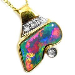 opal pendant: multi colored black opal with diamonds, set in 18 k yellow gold. #opalsaustralia