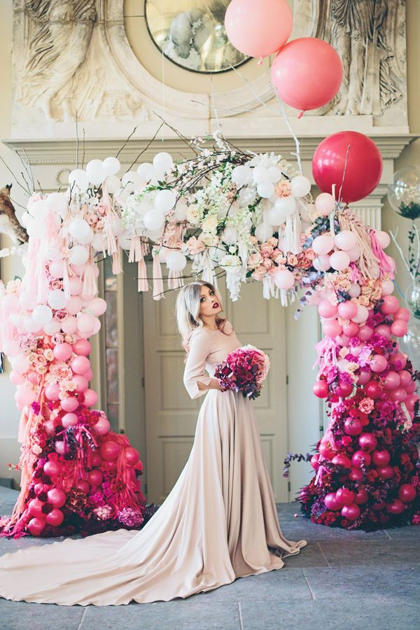 It doesn't really get more glam than this ombre balloon arch dripping with fringe and flowers. Definitely a more-is-more detail, you could have your wedding planner create something similar with any color palette, from pale to dark.