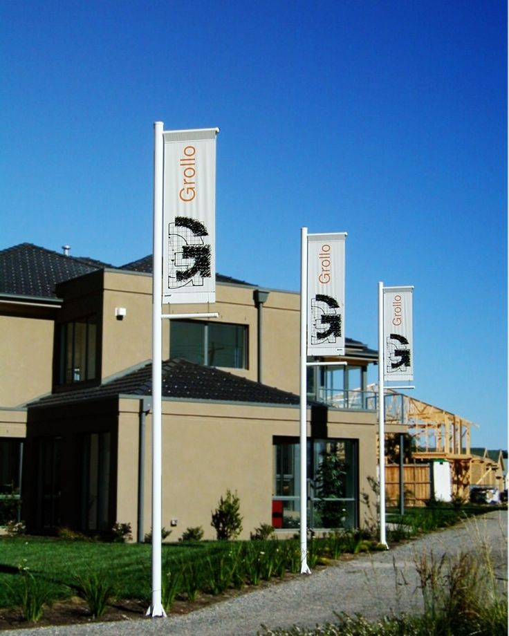 Banner poles with banner arms and printed vinyl banners.
