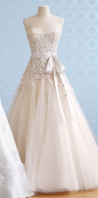 """Stunning gown. I typically don't like """"Beltsl on wedding dresses but this looks rather nice!"""