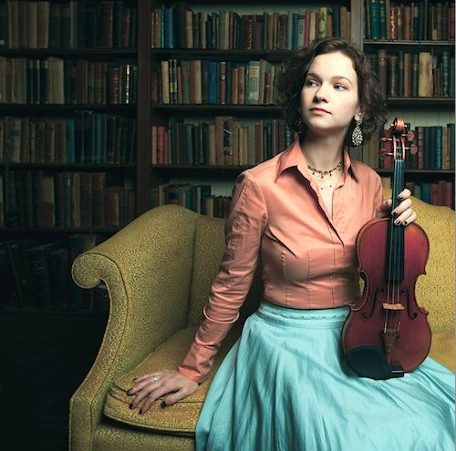 The beautiful Hilary Hahn with her violin in a library! <3