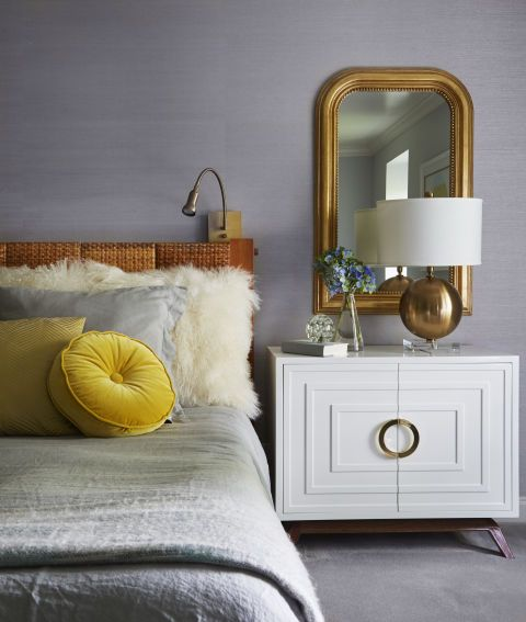 A lacquered bedside table with eclectic accents, designed by Amy Kartheiser Design.