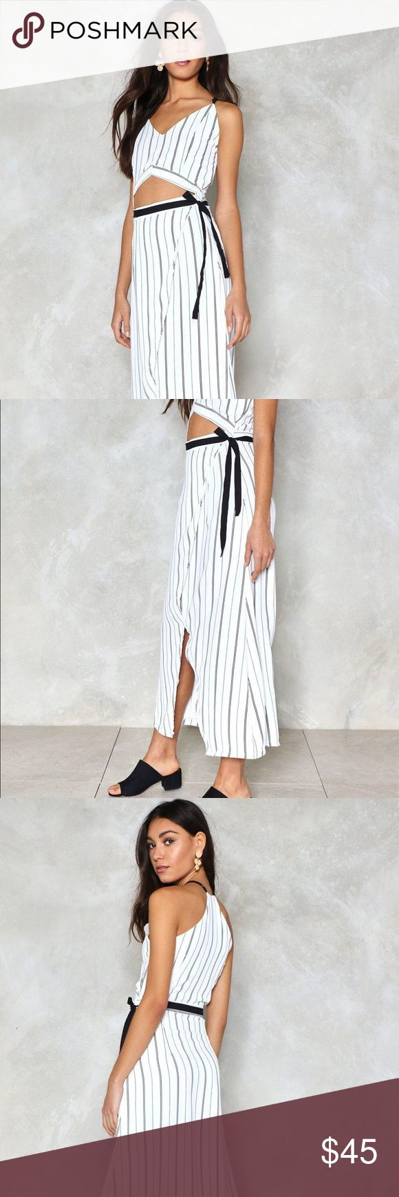 Nasty Gal- Blue and White Stripped Maxi Dress Amazing dress, so flowy and lightweight! Beautiful cutout in the front with navy blue ribbon detail. Slit up the side that's super flattering. Brand new Nasty Gal Dresses Maxi