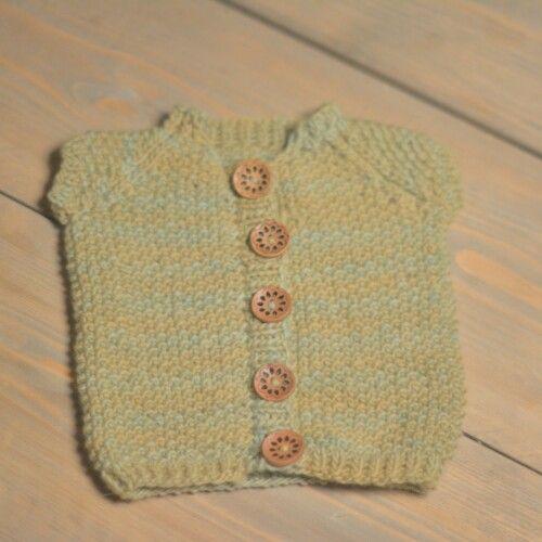 Babys knitted vest.