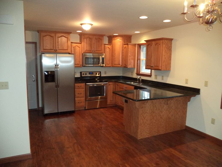 The Kitchen Of A Yorktown I Oak Cabinets With Wheat Finish