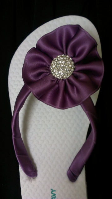 buy cheap flip-flops and have a girls night decorating them so you have shoes to change into for reception!