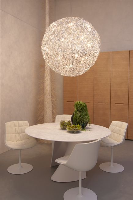 A Fil de Fer pendant light fixture by Catellani and Smith hangs over a S-Table in matte white resin by MDF Italia, surrounded by glossy Flow chairs. Along the wall is the Centopercento closet system by Tisettanta.Don't miss a word of Dwell! Download our FREE app from iTunes, friend us on Facebook, or follow us on Twitter!