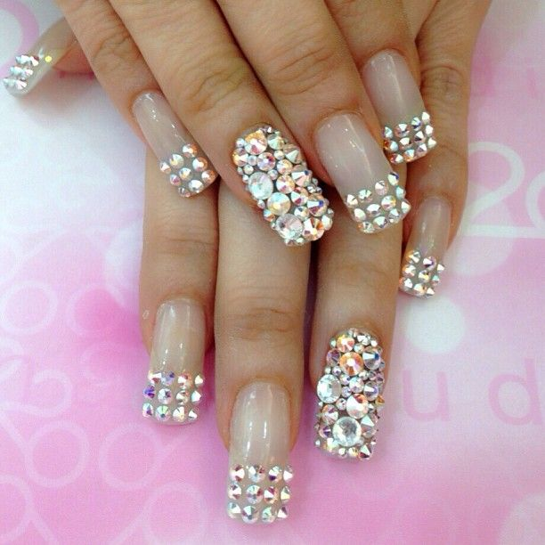 I'd love to have my nails done this way, but unfortunately the little rhinestones/jewels would fall off almost immediately! :(