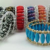 Picture: Memory Wire Cuff Bracelet  with duct tape beads.  (link is a tutorial on how to make duct tape beads - idea: use stirrers instead of straws)