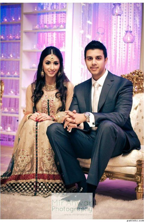 Very beautiful couple. Love the bride's outfit!