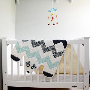 Thr Arctic Bear is in a blue and white chevron pattern, with a light yellow backing.They are designed to be a snuggly and cheery part of your everyday life and are made to last and can handle gentle wear and tear.  Egg Quilts are constructed using 100% cotton materialsfrom the fabrics, to the batting, and all the way down to the thread. All quilts are machine pieced, machine quilted and machine binded...