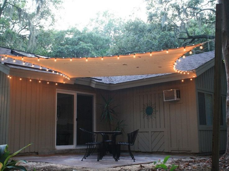 Patio Sails Sun Shades With Light Over Black Iron Dining