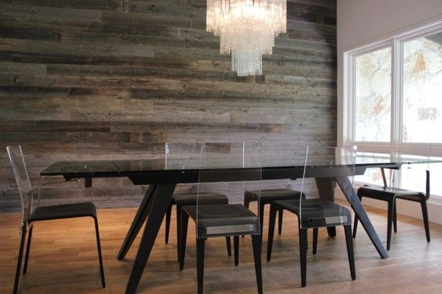 Urban Woods Company: Rustic chic dining room with barn wood paneled walls and hardwood floors....