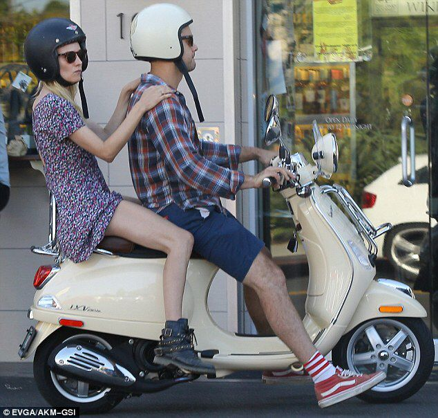 Diane Kruger and Joshua Jackson riding a Vespa scooter ...