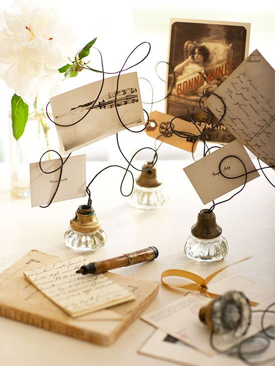 Repurpose vintage doorknobs as free-form picture frames by twisting rebar wire into curlicue forms.