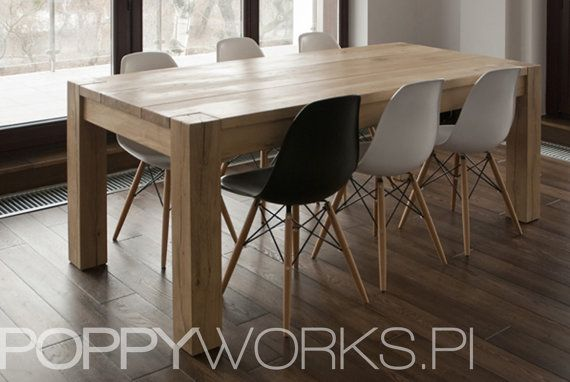 A custom-made table. Made of solid oak timber, natural color-waxed. 200 x 90 x 76cm (lenght x width x height). Unique modern design. Its always made to order. Please contact us for shipping costs and details.