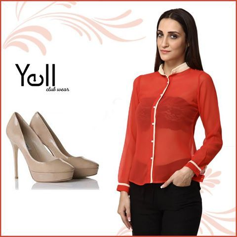 Pair this sheer red shirt with black pants and nude pumps for a semi-formal look