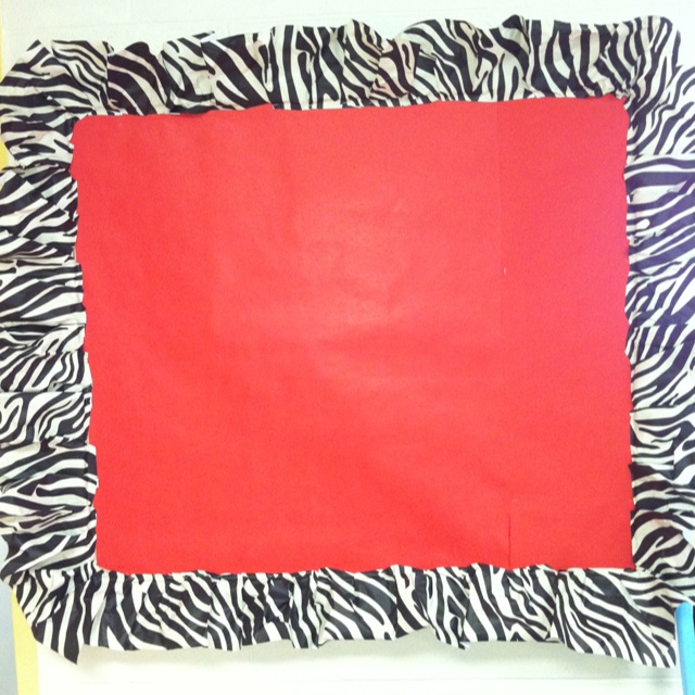 This one was my first bulletin board! Zebra butcher at Hobby Lobby-- again, crinkled and pleated to make ruffle around bulletin board. It helps to put the background paper on first, then ruffle, last the border to cover up staples around ruffle (not shown)