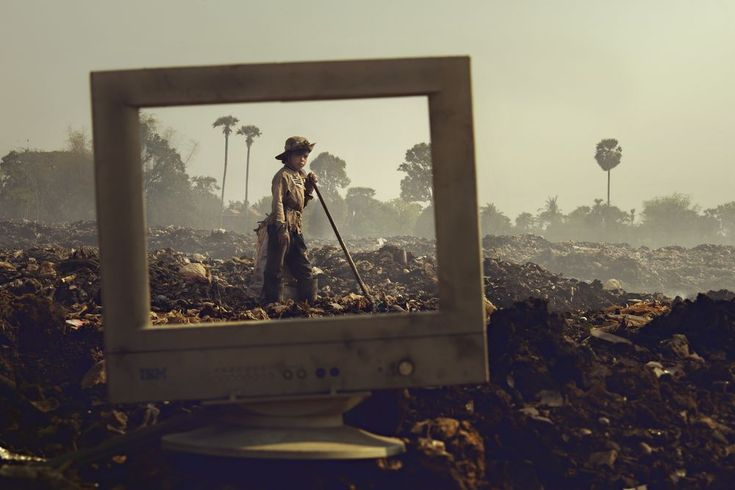 A Young Garbage Scavenger of Siem Reap Photo by Yap Kh — National Geographic Your Shot