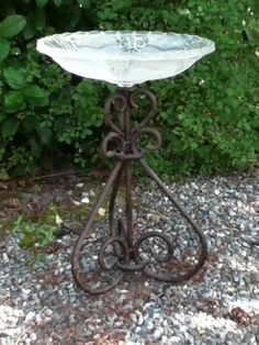 Birdbath, using vintage glass lamp shade and wrought iron lamp base.