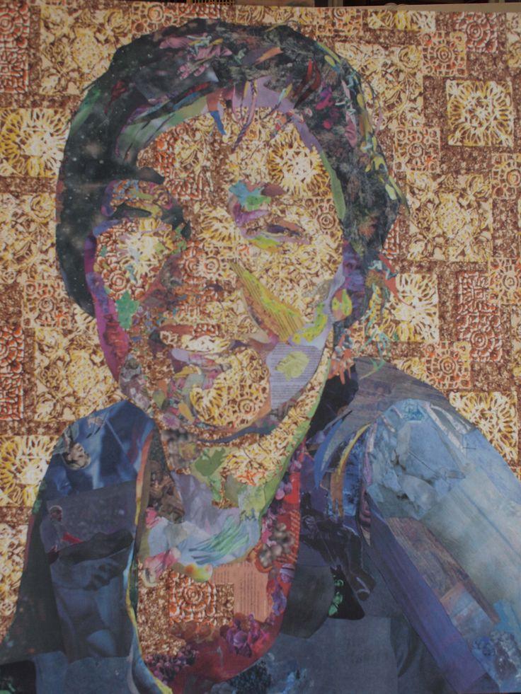 Judith in wallpaper and pieces of newspaper (de Volkskrant)