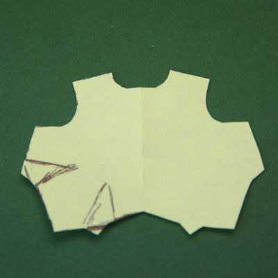 Basic flat paper pattern or sloper for the front torso of a female doll, used to make custom clothes