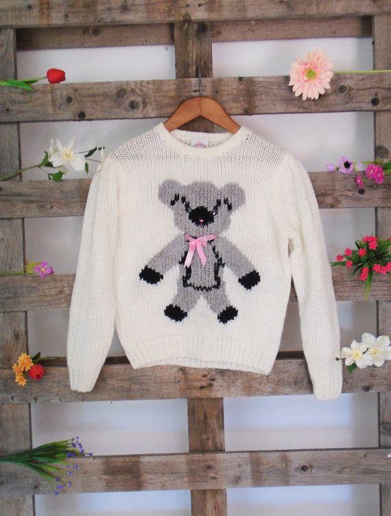 A warm and cozy vintage teddy bear jumper in a size medium.