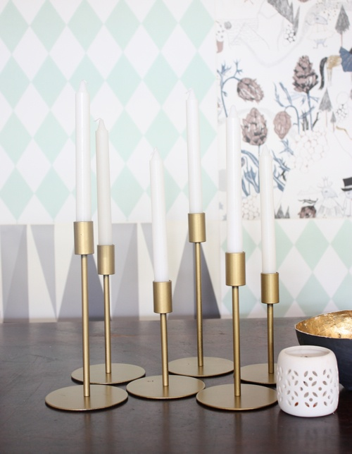 http://www.ikea.com/us/en/catalog/products/80147687/ IKEA candlesticks spraypainted with brass paint