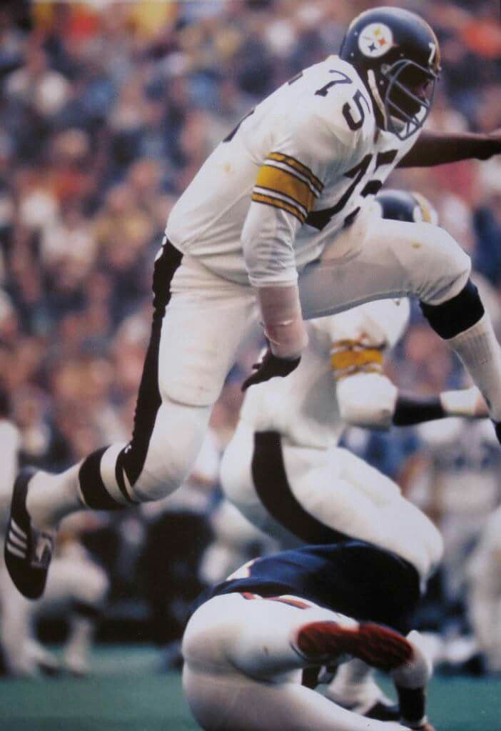 c8fafe080 Mean Joe Greene showing off the rare all-white Pittsburgh Steelers uniform  in 1971