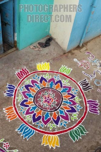 "Kolam The kolam, or ""rangoli"" is a traditional mandala, a geometric pattern, that women design in front of their houses during festivities. In Tamil culture is a strong form of expression by the women, who express their feelings in this secret way."