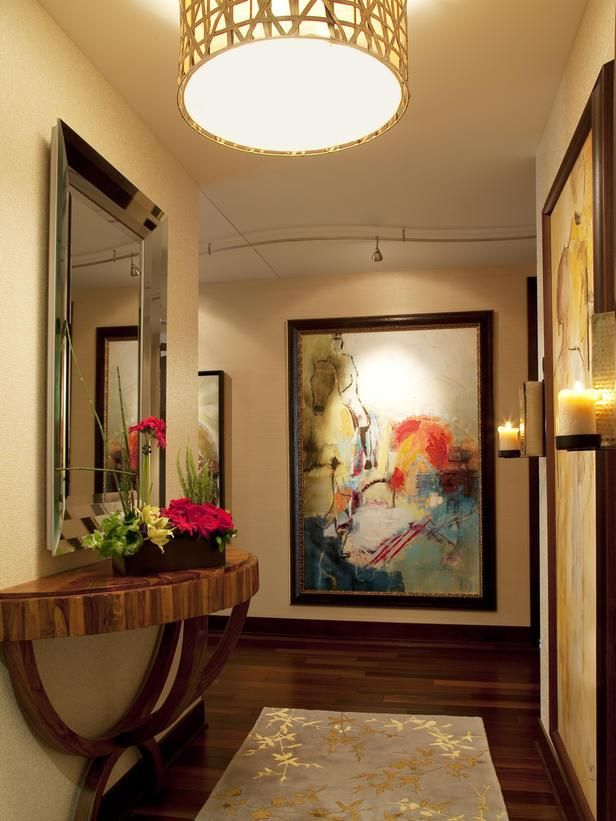 Large Framed Mirrors And Art May Be The Perfect Solution To Add Color And Character To Those Big