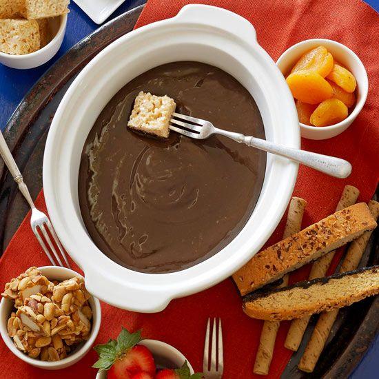 Chocolate-Caramel Fondue Sauce...condensed milk, carmel & chocolate!  Serve over ice cream or pound cake...yes please!
