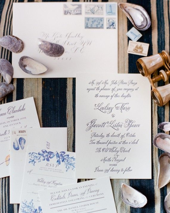 Kearsley Lloyd, a personal friend of the couple, designed all the paper goods, including letterpress invitations with a custom crest, reception cards, reply cards, envelopes with a mussel shell stamp, and rehearsal dinner invites with a watercolor lobster design. Digby & Rose printed the invitations, and Laura Hooper Calligraphy calligraphed the envelopes in navy ink. The bride collected vintage stamps in shades of blue to mail them.