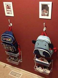 Put hooks and low shelves on wall for kids' backpacks and mittens