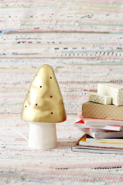 What a beautiful idea! Ever charming mushroom in *gold*. Would love to see this lamp, lit. {Also need to make cookie version}.